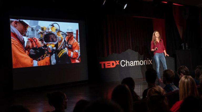 Dorota presenting pictures during her public speech